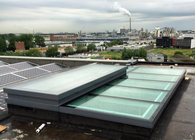 Glass roof with Skydoor roof hatch acces on Superloft Amsterdam